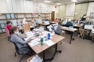 Marcus Larson/News-Register file photo##Election processers work in the Clerks office last month on election night.
