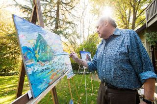 Marcus Larson/News-Register##With several canvases set up in his backyard in McMinnville, artist Rick Schanche adds paint to a landscape. He likes to work fast, using large brush strokes and moving among several canvases at once.