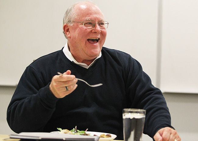 Rockne Roll/News-Register##Scott Hill jokes with fellow McMinnville city councilors during the dinner meeting Tuesday evening.