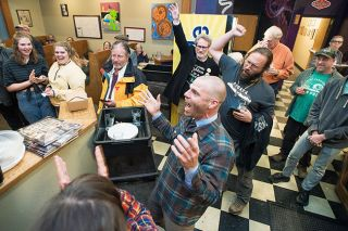 Marcus Larson/News-Register##County Commissioner candidate Casey Kulla celebrates with friends, family and supporters at 3rd Street Pizza in McMinnville following release of initial election results gave him a  sizable lead over incumbent Stan Primozich.