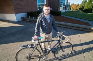 Marcus Larson/News-Register ## Science teacher Levi Grabner prepares to pedal home from Duniway Middle School. Before starting his first year of teaching, he spent 34 days riding on a solo cycling trip.