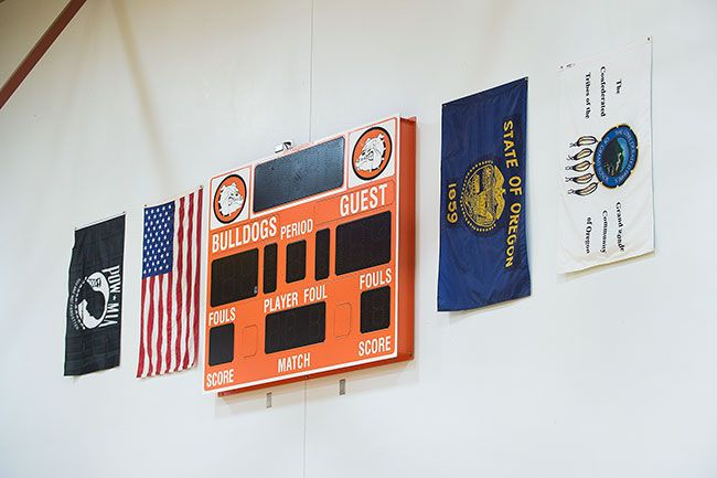 Marcus Larson/News-Register##The Grand Ronde flag now hangs beside others in the gym.