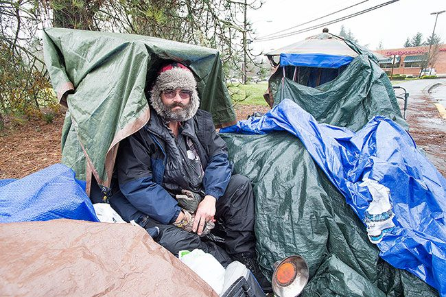 "Marcus Larson/News-Register##Paul Nelson, 57, is one of two homeless men camping across from Walgreens Pharmacy at the corner of Southeast Baker and South Cowls streets. He shares the space with his friend, Rick ""Max"" McMahon, who is in the hospital suffering from hypothermia and dehydration following a stroke. A GoFundMe account has been established to help Nelson and McMahon."