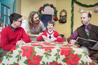 "Marcus Larson/News-Register##Mom (Cathy Willoughby) cajoles Randy (Will Sandburg) to eat, confounding Ralphie (Connor Frost) and his dad (John Hamilton). ""A Christmas Story"" opens Friday at Gallery Theater in McMinnville."