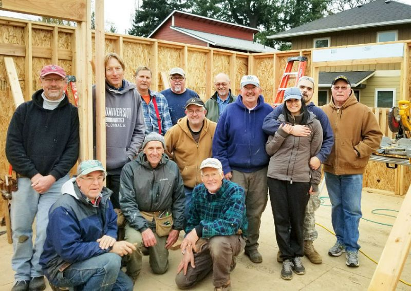 Submitted photo##Doug Cruikshank (kneeling in front center) poses with other members of Habitat for Humanity's Veterans Build crew and new homeowners Ed and Elizabeth Floyd (hugging toward right). Ed is a veteran of the U.S. Army.