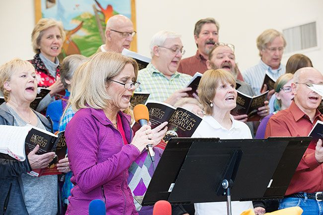 Kathy Bernards of the Christmas Cantata Choir sings a solo during a practice session last Saturday. 