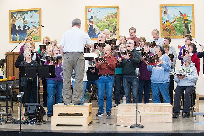 Christmas Cantata Choir director Lee Schrepel leads the group during a practice session last Saturday. 