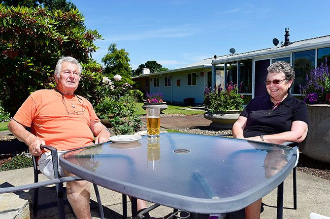 News-Register file photo ## George and Carolyn Stastny also are thankful to have a nice backyard in which to relax during warm weather.