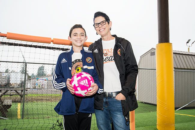 Marcus Larson/News-Register  ## Lucas Partin and his mom, Michelle, are thankful to be able to spend time at the Yamhill Carlton Soccer Club's arena in downtown Carlton. In addition to playing there, Lucas, a seventh-grader, helps coach younger kids.