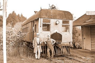"Image: Ben Maxwell/Salem Public Library##Engineers P.W. ""Casey"" Jones and Floyd Robbins pose with the ""Valsetz Zephyr,"" a gasoline-powered self-propelled railroad coach that provided the passenger service between Valsetz and Independence, in 1938. The Zephyr was built in Seattle in 1918."