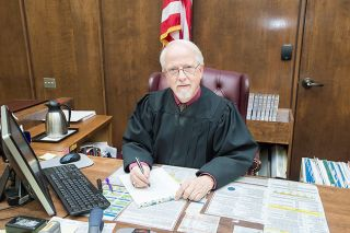 Marcus Larson / News-Register##Judge John Collins is stepping down as the presiding judge of the state s 25th Judicial District.