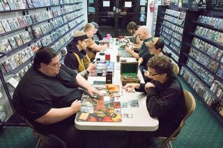 Helen Lee/News-Register##Pairs of Magic players duel during the weekly Friday Night Magic tournament on Nov. 20.