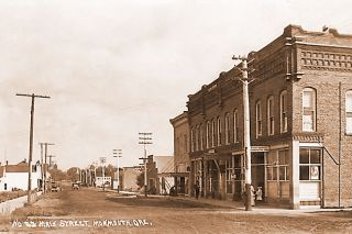 ##The main street of Monmouth as it appeared in 1915. This location is still readily recognizable today.