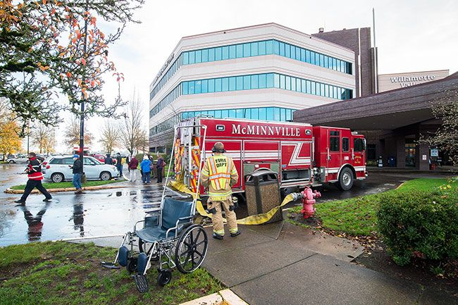 Marcus Larson/News-Register##Firefighters responded to the Willamette Valley Medical Center Wednesday morning. Light smoke was reported on the third floor.
