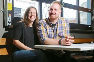 Rockne Roll/News-Register##Kim and Nick Walton of Flag & Wire Coffee, pictured at their shop in the Granary District in McMinnville.