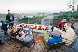 Marcus Larson/News-Register##Several wine tasters enjoy sitting around an outdoor fireplace at Brooks Winery this past weekend. Many area wineries did brisk business over the Thanksgiving holiday.