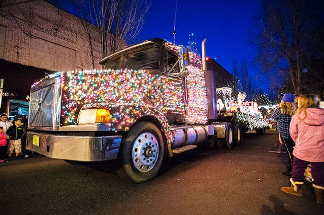 Marcus Larson/News-Register##A semi truck full of Christmas lights rolls down Third Street during the annual Christmas parade.