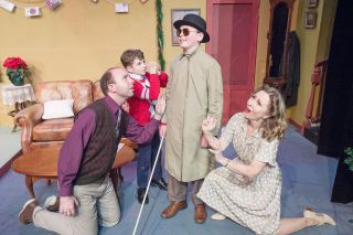 "Marcus Larson/News-Register##In Gallery Theater's ""A Christmas Story,"" Ralphie (Connor Frost) fantasizes about how sorry his family (John Hamilton, Will Sandburg and Cathy Willoughby) would be if he went blind from soap poisoning."