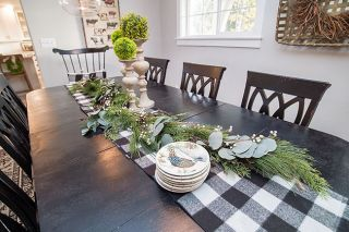 Marcus Larson/News-Register ## The Hartzell family's formal dining table is set with neutral decorations, topiary and eucalyptus leaves for the Christmas season.