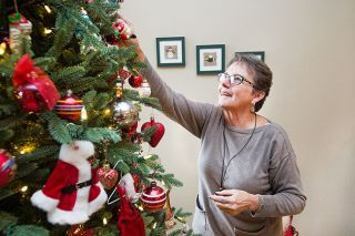Marcus Larson/News-Register##Sandy Bartnik and her husband, Wayne, love decorating for Christmas. This year, they'll open their McMinnville house for the Soroptimists' Wine Country Tour of Homes.