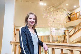 Marcus Larson/News-Register##Marit Berning matches together artists and spaces, as she did with this mobile by Britain's Martin Richman for the atrium of Walker Hall on the Linfield College campus. Richman is known worldwide for capturing light in his sculptures.