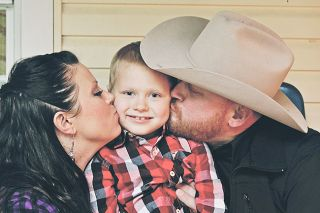 Submitted photo##Cassylou and A.J. Miller with their son, Brody.