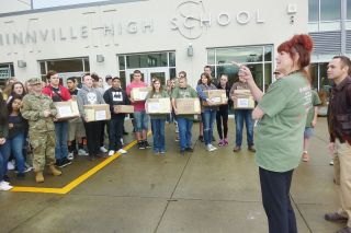 Starla Pointer / News-Register##Members of the Pay It Forward Club and other McMinnville High School students prepare to send gifts to recent graduates serving overseas.