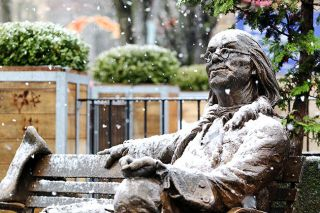 Rockne Roll/News-Register##Snow falls on the Benjamin Franklin statue at U.S. Bank Plaza in McMinnville on Monday, Dec. 5. Wintry precipitation fell sporadically throughout the day around the valley, with more white stuff forecast for overnight.