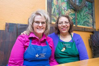 Marcus Larson/News-Register##Norma Huettl and Lupe Villa share a love of cooking, children and community. Lupe and her husband recently retired from their Dayton cafe, Lupita's; new owners Norma and her husband call it Lonestar Barbecue.