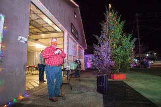 Marcus Larson/News-Register##Amity Mayor Michael Cape addresses residents after lighting the town's Christmas tree earlier this month. Cape didn't run for reelection this year and attended his final city council meeting as mayor on Dec. 2.