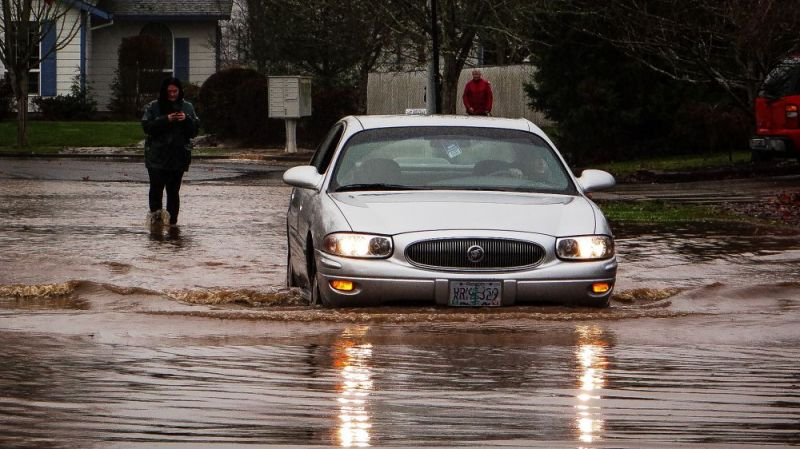 Photo submitted by Jay Switala##Bobby Burger driving to his residence on Darci Dr. in Mcminnville as his mother, in background, worries about him having to drive home from school in Amity.
