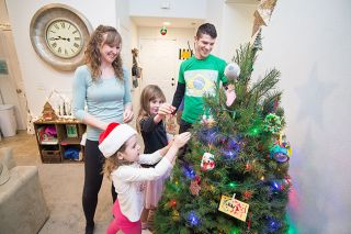 Marcus Larson / News-Register## The Martins family -- Meghan, Gabriela, Gisele and Murilo -- decorate their tree for Christmas. They sometimes see snow during the holidays in McMinnville, something Murilo would never have experienced in his native country, Brazil.