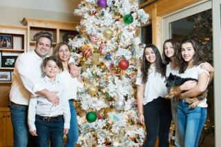 Rusty Rae/News-Register##The Gigenas gather around their white flocked tree. At left are dad Manuel, mom Nevenka and son Mateo. At right are daughters Ariana, Kyara and Malia.