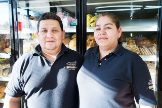Marcus Larson/News-Register##Ignacio Veles and his wife, Ibeth, work together in their bakery, Noah's, on Highway 99W in McMinnville. Both are from Michoacan, Mexico.