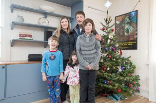 Marcus Larson/News-Register##A Christmas tree decorates the living room of the Leahy family — parents Justin and Lindley, sons Ryder and Osian, and daughter Catalina. The Leahys live on Foothills Farm, near Carlton.