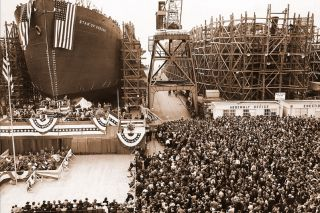 Image: Oregon Historical Society##A massive crowd of onlookers gathers on Sept. 27, 1941, to watch as the Star of Oregon, the first Liberty ship, is launched into the Columbia at Henry Kaiser's Oregon Shipbuilding Company.
