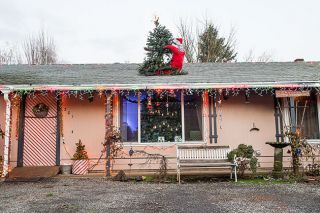 Marcus Larson / News-Register##Santa is on the roof along with the top of the Pekareks  Christmas tree.