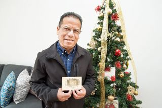 Marcus Larson/News-Register ## Gerardo Partida holds the first gift he ever gave to his mother, a postcard with his picture on it. He made it in May of 1972, when he was an 11-year-old boy in Campo General, Mexico.