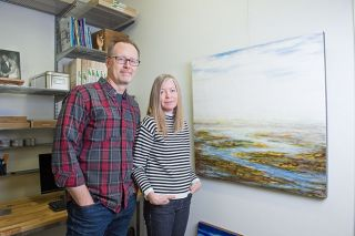 "Mark and Julia Hamilton show off one of their collaborative works. Asked if they ever disagree on a joint project, Mark quipped, ""Sure we argue, just not about art."" Rusty Rae/News-Register##"