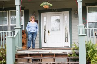 Rusty Rae / News-Register##Kathie Oriet stands on the porch of her home in Carlton, where she has been an elected official for more than 30 years.