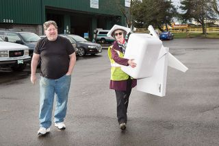 Rusty Rae / News-Register##Zero Waste volunteer Annely Germaine, right, assists Devon Cutrell with a load of foam packaging that will be sent to the Agilyx Corporation in Tigard.