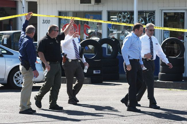 Rockne Roll/News-Register##Law enforcement team, led by Yamhill County District Attorney Brad Berry, far right, investigate officer-involved shooting.