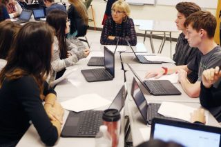 Rockne Roll/News-Register##Education secretary Betsy DeVos listens to students discuss poetry in Matt Brisbin s class at Mac High Wednesday afternoon. She also visited AVID and U.S. history classes.