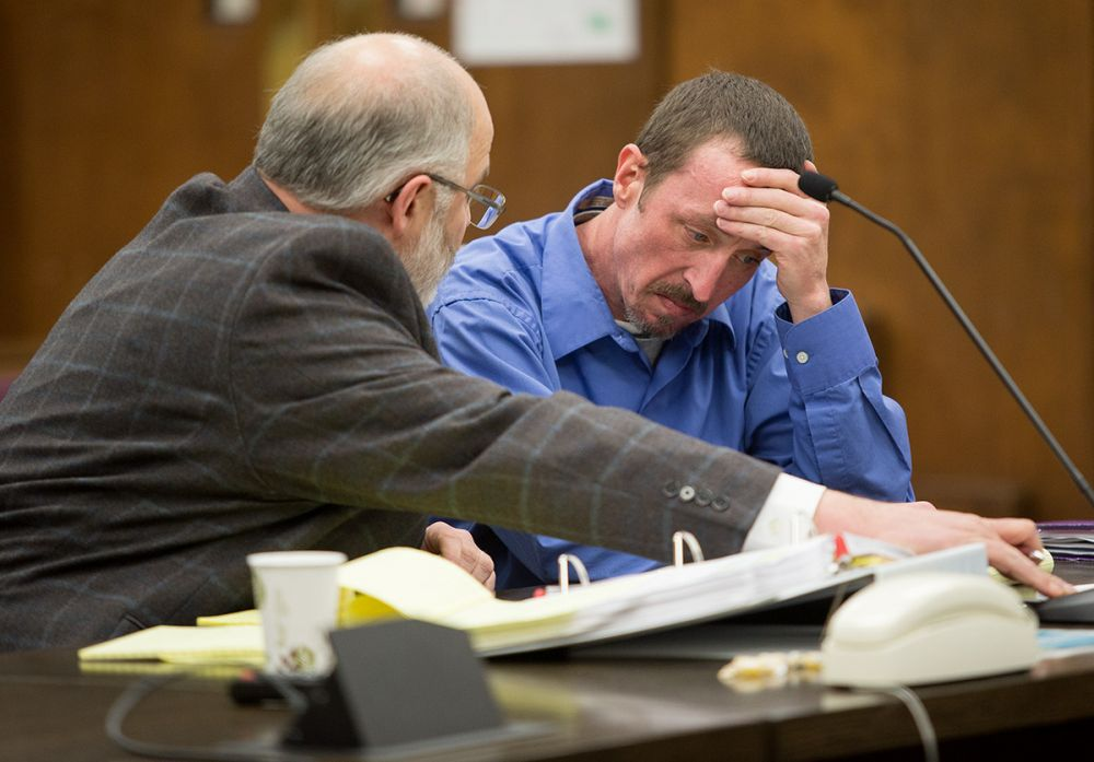 Rockne Roll / News-Register##Timothy McCready, right, reacts to testimony from Steve Livasy Wednesday during his manslaughter trial  in the Yamhill County Courthouse.