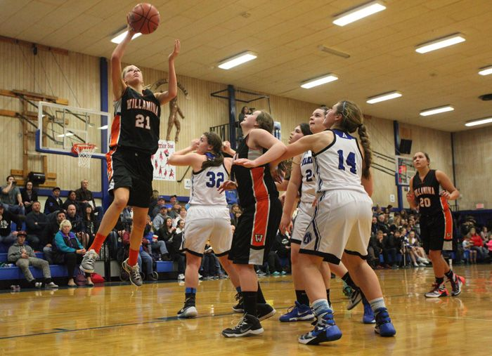 Rockne Roll/News-Register##Willamina senior guard Kasey Anderson (21) scored eight points in the Bulldogs  61-45 loss to Amity Monday night.