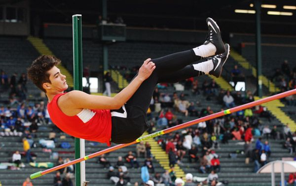 Rockne Roll/News-Register##McMinnville freshman Antonio Robledo attempts to clear 6 feet even during the 6A boys  high jump final at Hayward Field in Eugene during the OSAA State Track and Field Championships.
