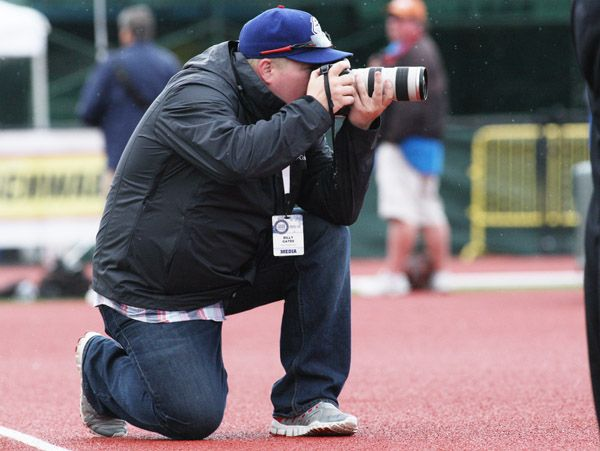 Rockne Roll/News-Register##Sports reporter Billy Gates of The Oregonian/Oregonlive competes in the sports photography preliminary round at the OSAA State Track and Field Championships Thursday at Hayward Field. Gates recorded 386 usable photos out of 1,947 taken on the first day of track and field action.