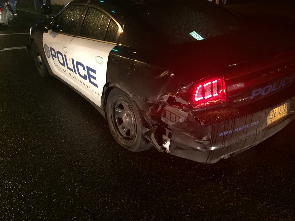 McMinnville Police Department photo##A patrol car was heavily damaged when struck by another car Thursday night. The officer sustained a minor injury.