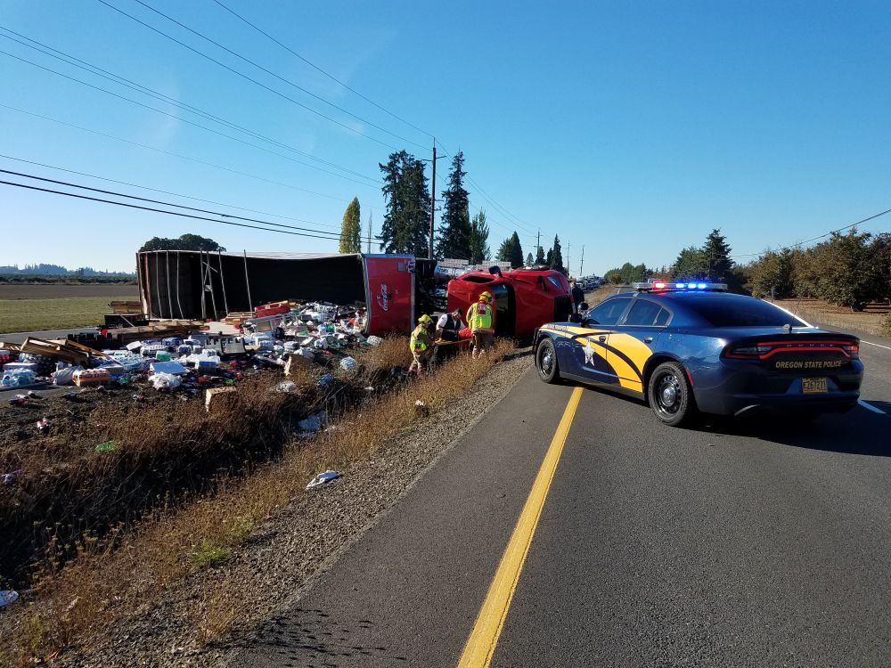 Photos courtesy Oregon State Police##A tractor-trailer rig lost its load of soda pop Thursday morning on Highway 99W.
