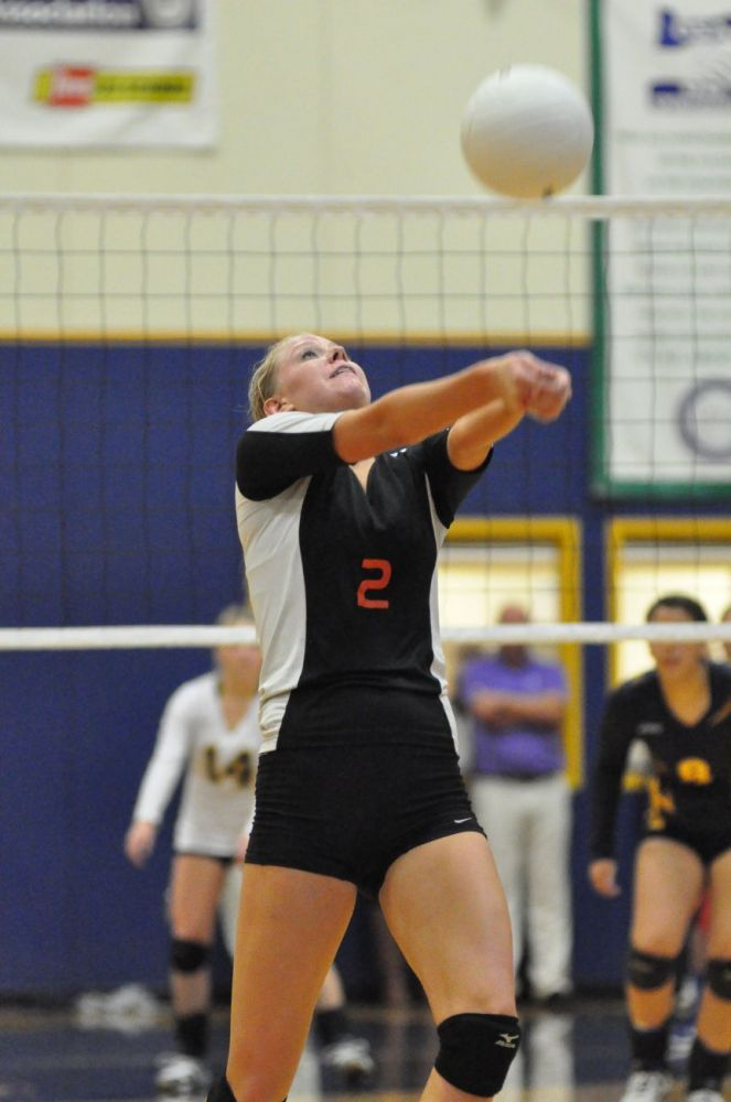 Robert Husseman/News-Register##Willamina senior Kasey Anderson hits a ball over the net during the Bulldogs  3-2 loss to Sheridan Thursday night.
